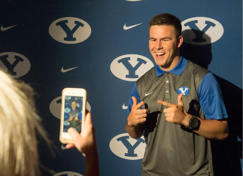 Rick Egan     The Salt Lake Tribune  BYU quarterback Tanner Mangum poses for Gabby Heroux at the annual football media day at the Broadcasting Building,Thursday, June 30, 2016.