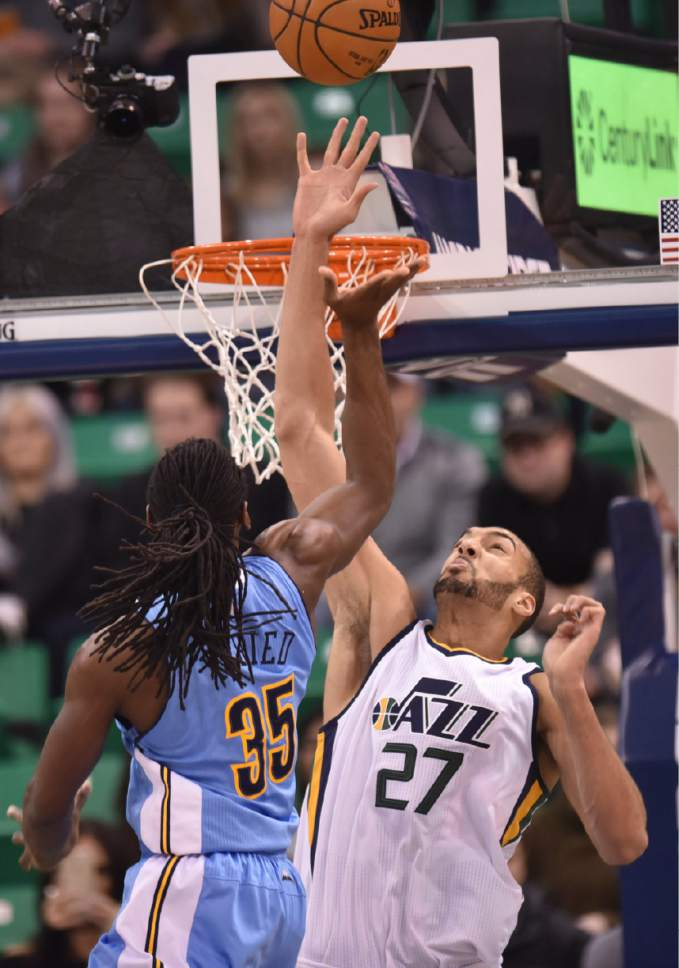 Lennie Mahler  |  The Salt Lake Tribune  Utah Jazz center Rudy Gobert blocks a shot by Denver's Kenneth Faried in the first half of a game at Vivint Smart Home Arena in Salt Lake City, Saturday, Dec. 3, 2016.