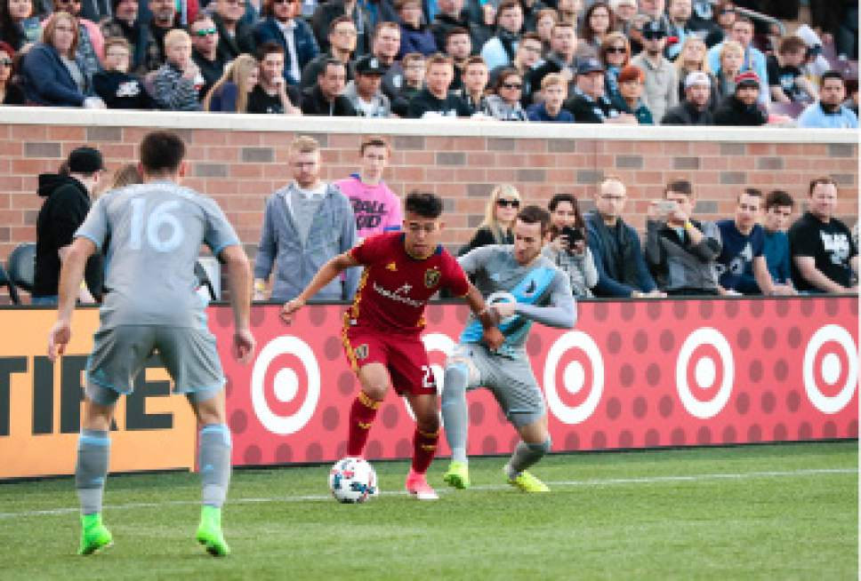 Real Salt Lake midfielder Sebastian Saucedo (23) dribbles with pressure from Minnesota United FC defender Jerome Thiesson (3) during their match at TCF Bank Stadium in Minneapolis, MN on Saturday, April 1, 2017. RSL lost the match 4-2. Courtesy Photo | Minnesota United FC