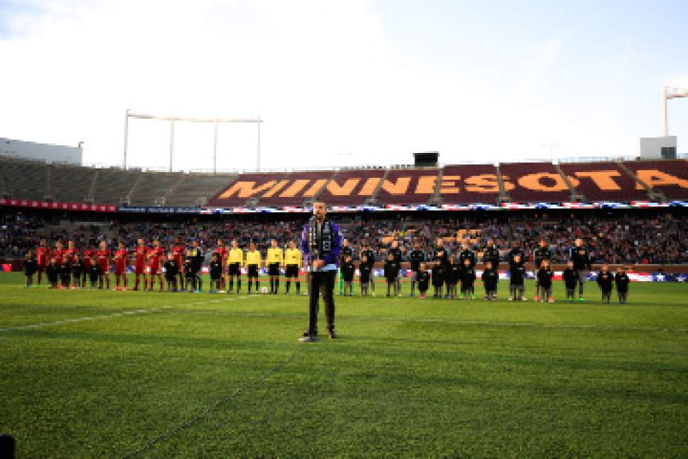 Players listen to the national anthem before the beginning of the MLS match between Minnesota United FC and Real Salt Lake at TCF Bank Stadium in Minneapolis, MN on Saturday, April 1, 2017. RSL lost the match 4-2. Courtesy Photo | Minnesota United FC