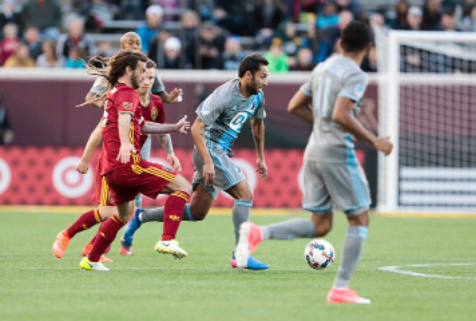 Minnesota United FC midfielder Ibson (7) dribbles passed Real Salt Lake midfielder Kyle Beckerman (5) during their match at TCF Bank Stadium in Minneapolis, MN on Saturday, April 1, 2017. RSL lost the match 4-2. Courtesy Photo | Minnesota United FC