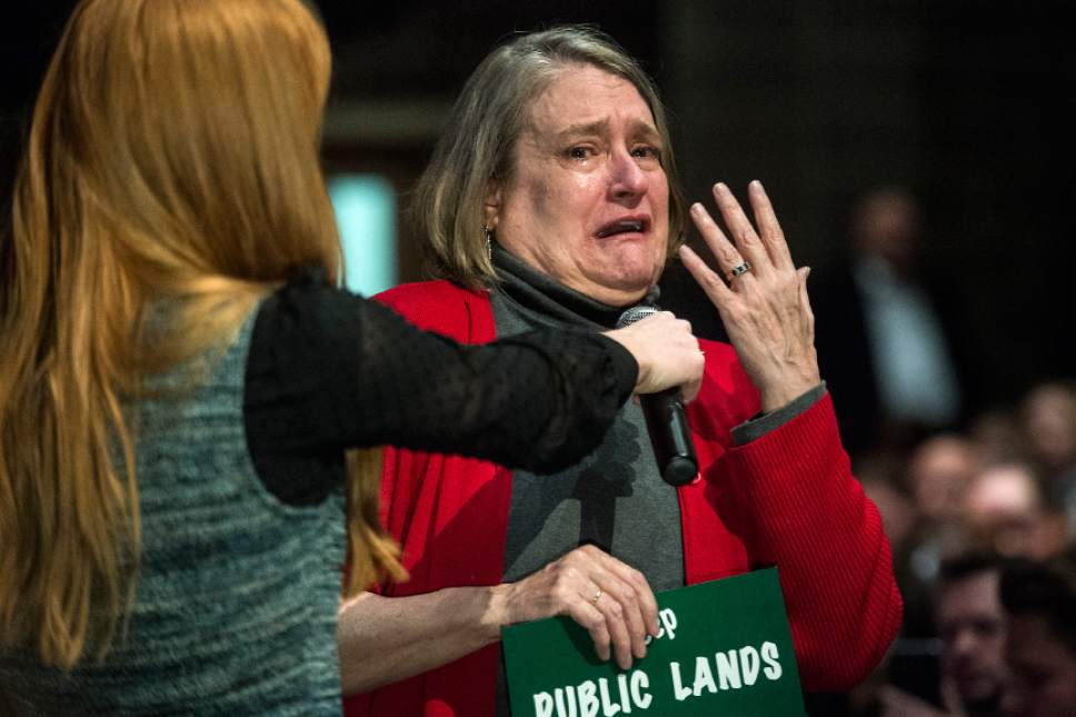 Chris Detrick  |  The Salt Lake Tribune Pat Winmill, of Salt Lake City, cries while attempting to clarify her earlier question about the environment to Rep. Chris Stewart during a town hall meeting at West High School Friday March 31, 2017.