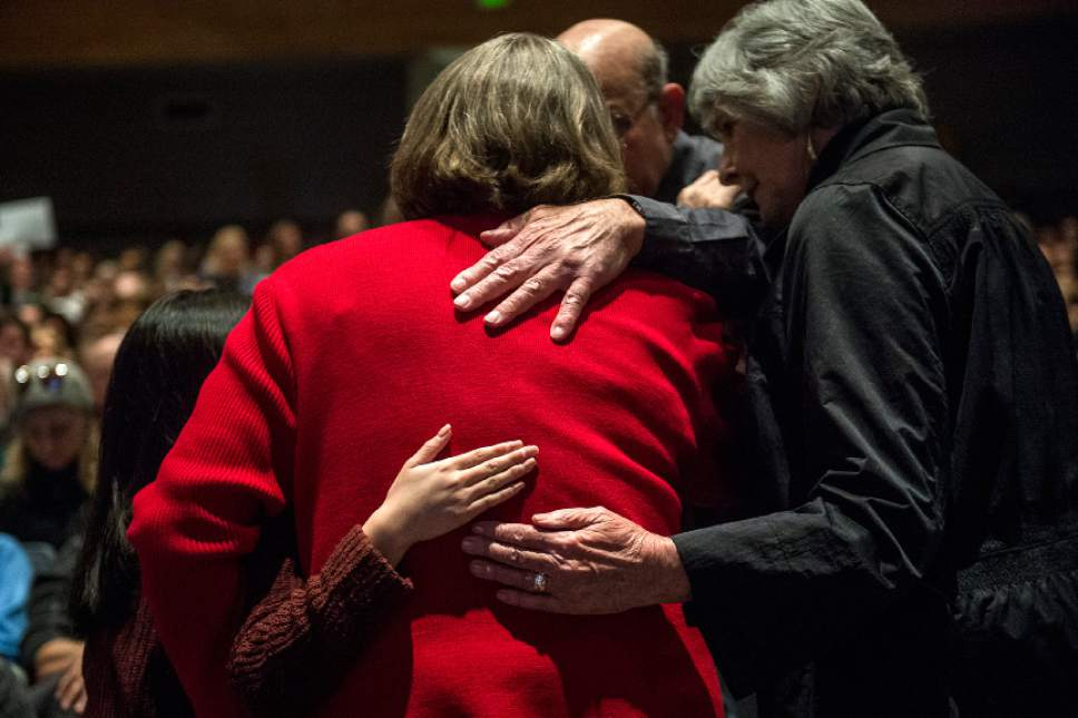 Chris Detrick  |  The Salt Lake Tribune Pat Winmill, of Salt Lake City, is hugged by other members of the audience after attempting to clarify her earlier question about the environment to Rep. Chris Stewart during a town hall meeting at West High School Friday March 31, 2017.