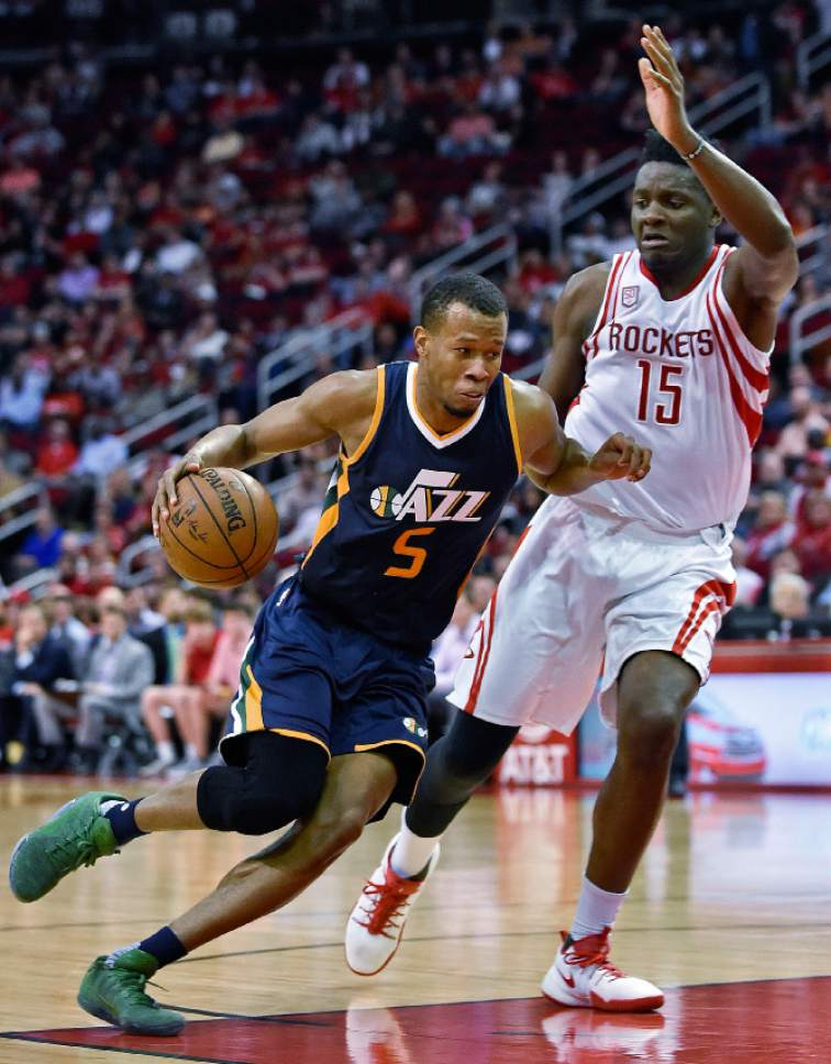 Utah Jazz guard Rodney Hood (5) drives past Houston Rockets center Clint Capela in the second half of an NBA basketball game, Wednesday, March 8, 2017, in Houston. Utah won 115-108. (AP Photo/Eric Christian Smith)