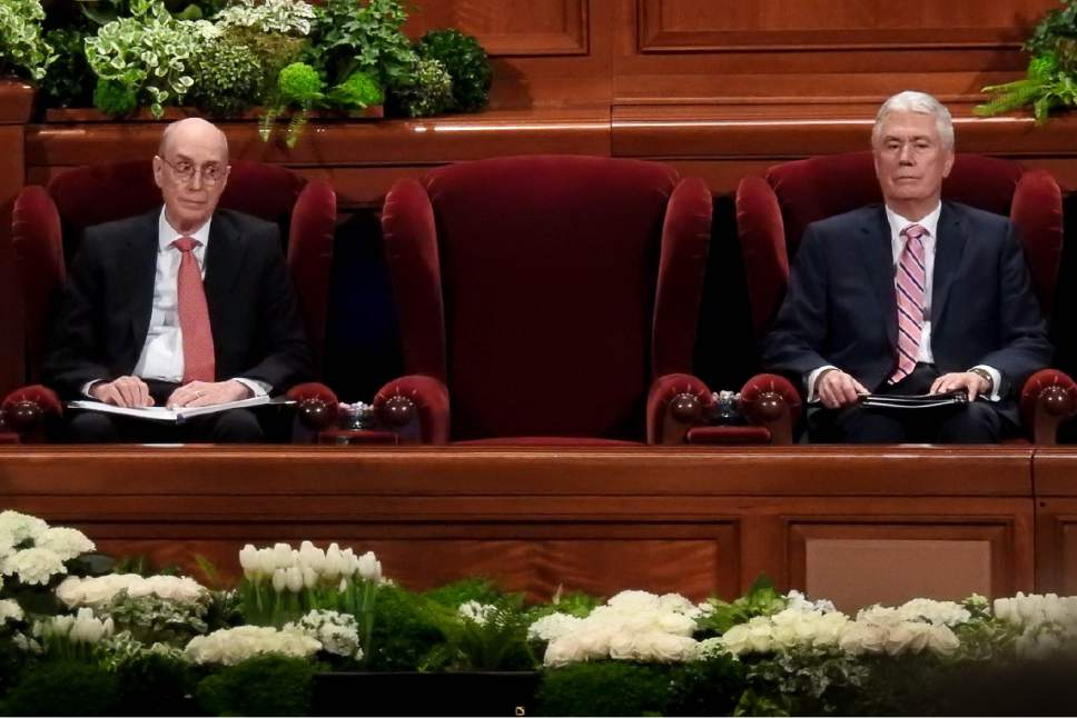 Trent Nelson  |  The Salt Lake Tribune Henry B. Eyring and Dieter F. Uchtdorf bookend President Thomas S. Monson's empty chair during the afternoon session of the 187th Annual General Conference at the Conference Center in Salt Lake City, Sunday April 2, 2017.