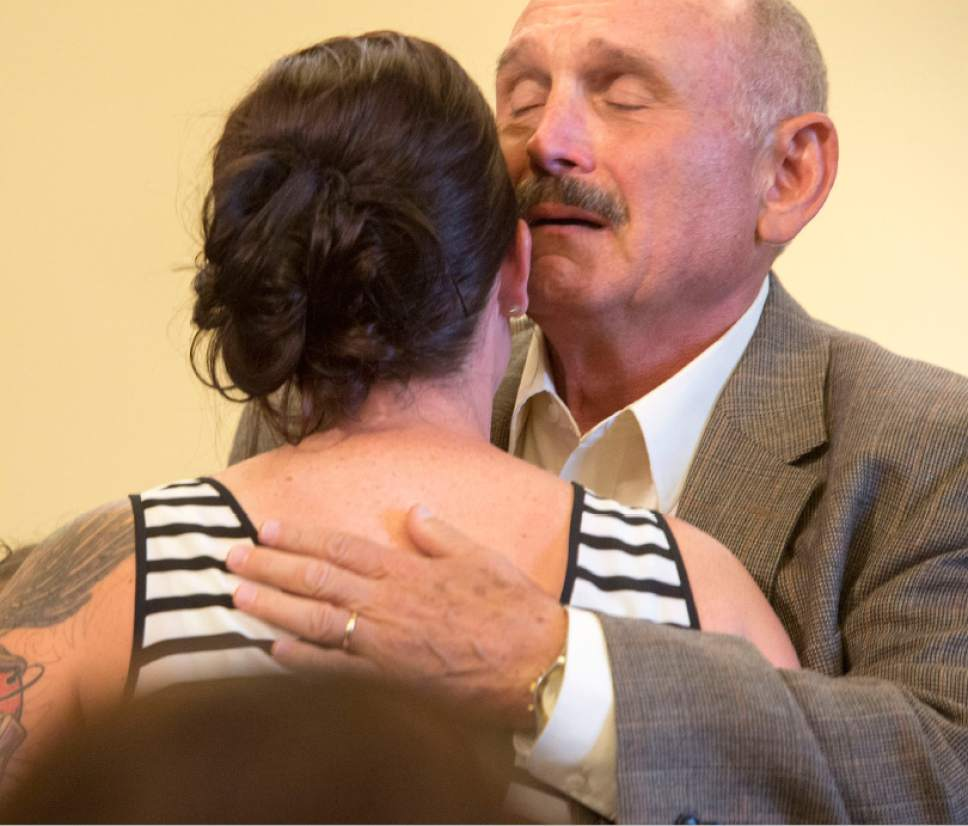 Rick Egan  |  The Salt Lake Tribune  Erin Finkbinder gets a hug from Dennis Cecchini at the FedUp Rally Utah on International Overdose Awareness Day at the Utah State Capitol, Monday, August 31, 2015. Cecchini lost his son Tennyson to an overdose.