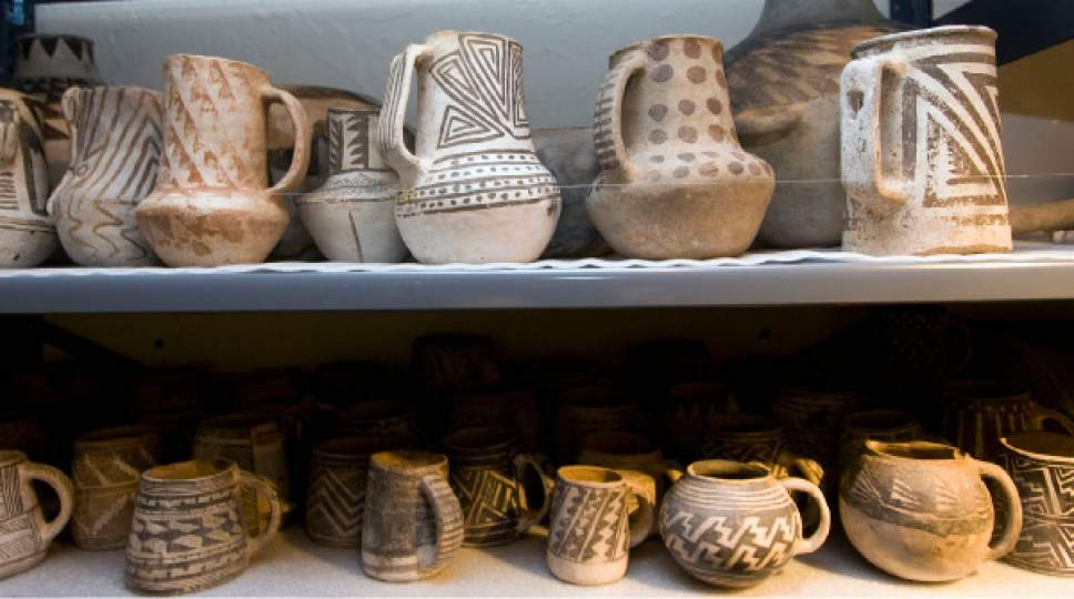Al Hartmann  |  Tribune file photo Some of the 900 Anasazi pots line several large racks at the Edge of the Cedars State Park Museum west of Blanding on June 12, 2009. The 900 pots are part of the Shumway, Holliday and Perkins collection sold to the Utah Navajo Trust Fund, which is considering donating donating them to the museum.