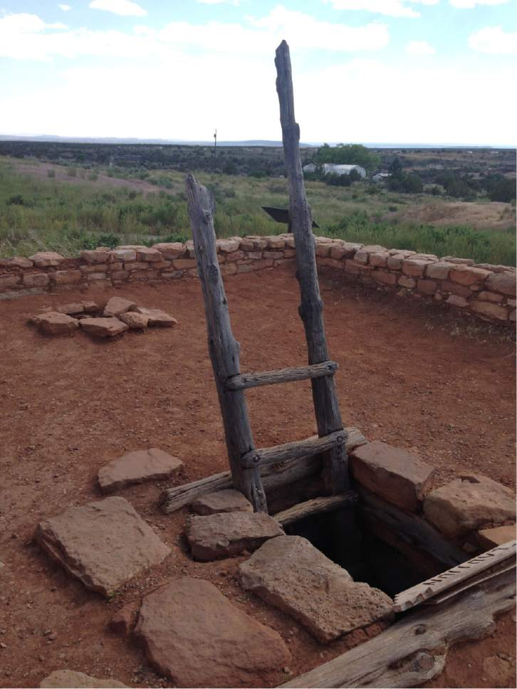 Erin Alberty  |  The Salt Lake Tribune  A ladder from the roof allows visitors to climb into a restored underground dwelling, called a kiva, at Edge of the Cedars State Park on June 11, 2016 in Blanding.