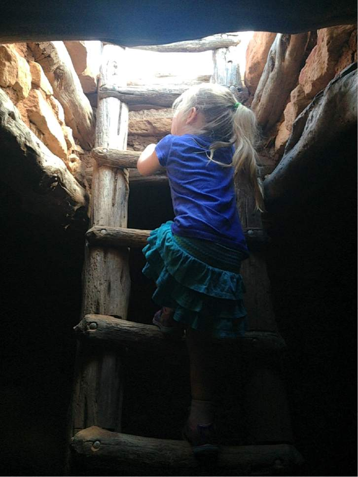 Erin Alberty  |  The Salt Lake Tribune  A young hiker descends the latter through the ceiling of a a restored underground dwelling, called a kiva, at Edge of the Cedars State Park on June 11, 2016 in Blanding.