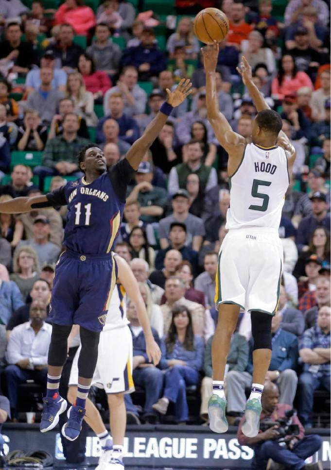Utah Jazz guard Rodney Hood (5) shoots as New Orleans Pelicans guard Jrue Holiday (11) defends during the first half in an NBA basketball game Monday, March 27, 2017, in Salt Lake City. (AP Photo/Rick Bowmer)