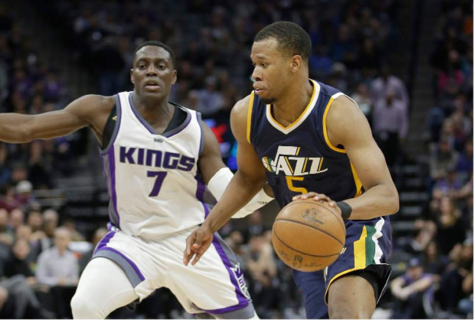 Utah Jazz guard Rodney Hood, right, drives against Sacramento Kings guard Darren Collison during the second half of an NBA basketball game Sunday, March 5, 2017, in Sacramento, Calif. The Jazz won, in overtime, 110-109. (AP Photo/Rich Pedroncelli)