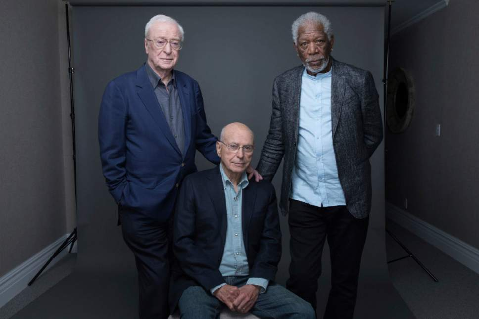 "In this March 27, 2017 photo, actors Michael Caine, from left, Alan Arkin and Morgan Freeman pose for a portrait to promote their new film ""Going in Style"" in New York. (Photo by Amy Sussman/Invision/AP)"