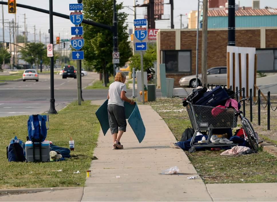 Al Hartmann  |  Tribune file photo Homeless woman breaks down her camp near 500 W. and 350 S. in Salt Lake City.