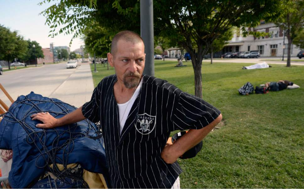 Al Hartmann  |  The Salt Lake Tribune Mark Isaksson who has been homeless in Salt Lake for a few years said that he is tired of dodging the drug dealers selling heroin near the entrance to the homeless shelter a block north at 500 W. 200 S.  He is among a new group of homeless who are camping out on the 500 West Commons just west of the Rio Grande Depot and a block or two south of the shelter.