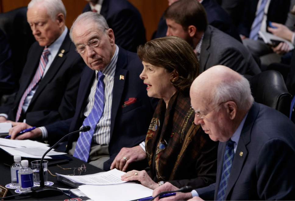 The Senate Judiciary Committee's ranking member Sen. Dianne Feinstein, D-Calif. speaks on Capitol Hill in Washington, Monday, April 3, 2017, to oppose the nomination of President Donald Trump's Supreme Court nominee Neil Gorsuch. From left are, Sen. Orrin Hatch, R-Utah, Committee Chairman Chairman Sen. Charles Grassley, R-Iowa and Sen. Patrick Leahy, D-Vt. (AP Photo/J. Scott Applewhite)