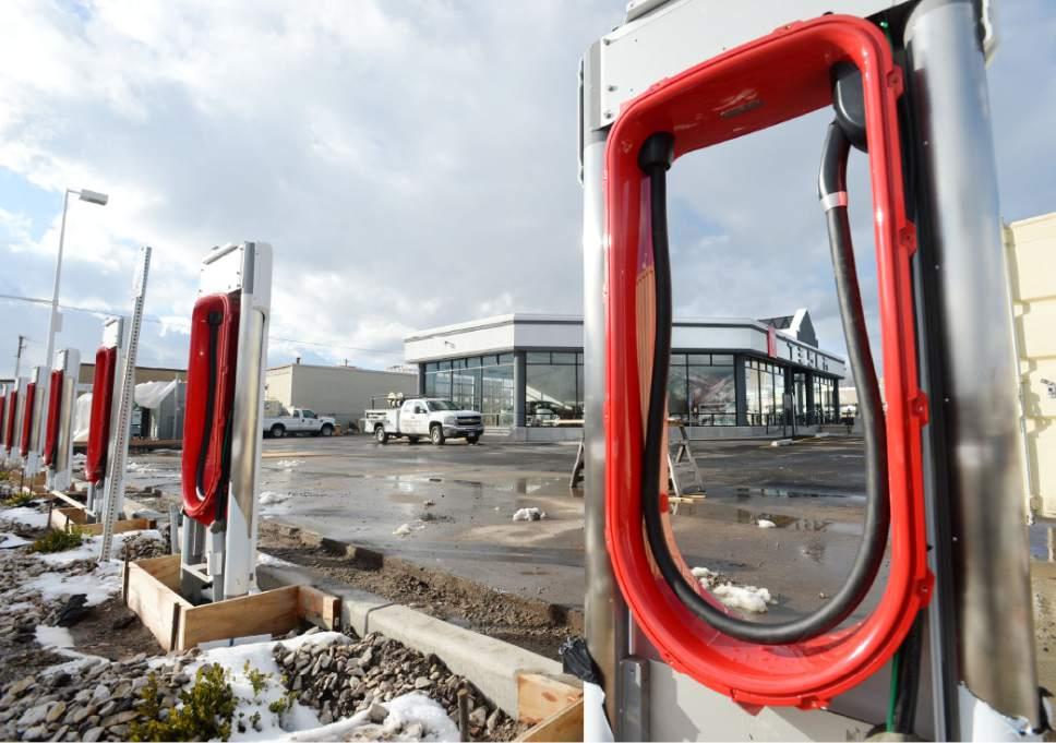 Steve Griffin  |  Tribune file photo  A new Tesla service center and car charging station at 2312 S. State St.was under construction in Salt Lake City in March. But company plans to sell direct to consumers was stymied by a state law limiting sales to dealers. Talks are underway about a possible compromise deal.