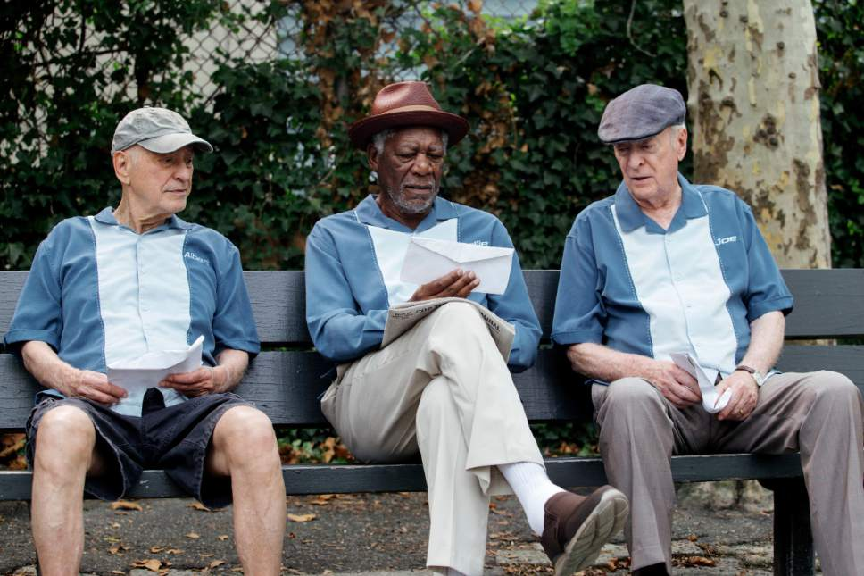 """In this image released by Warner Bros. Pictures, Alan Arkin, from left, Morgan Freeman and Michael Caine appear in a scene from """"Going in Style."""" (Atsushi Nishijima/Warner Bros. Pictures via AP)"""