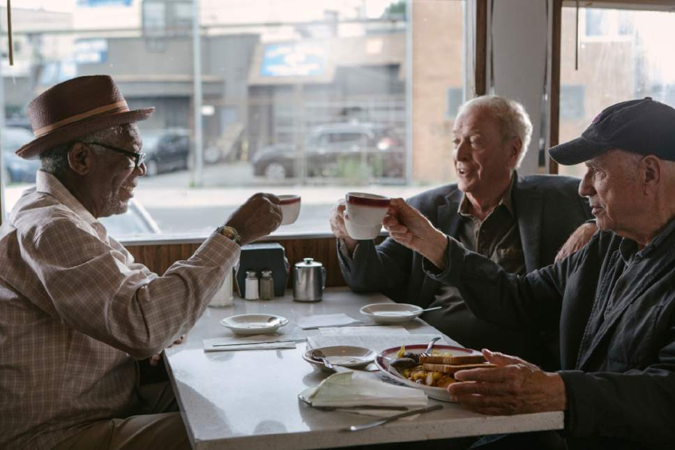 """In this image released by Warner Bros. Pictures, Morgan Freeman, from left, Michael Caine and Alan Arkin appear in a scene from """"Going in Style."""" (Atsushi Nishijima/Warner Bros. Pictures via AP)"""