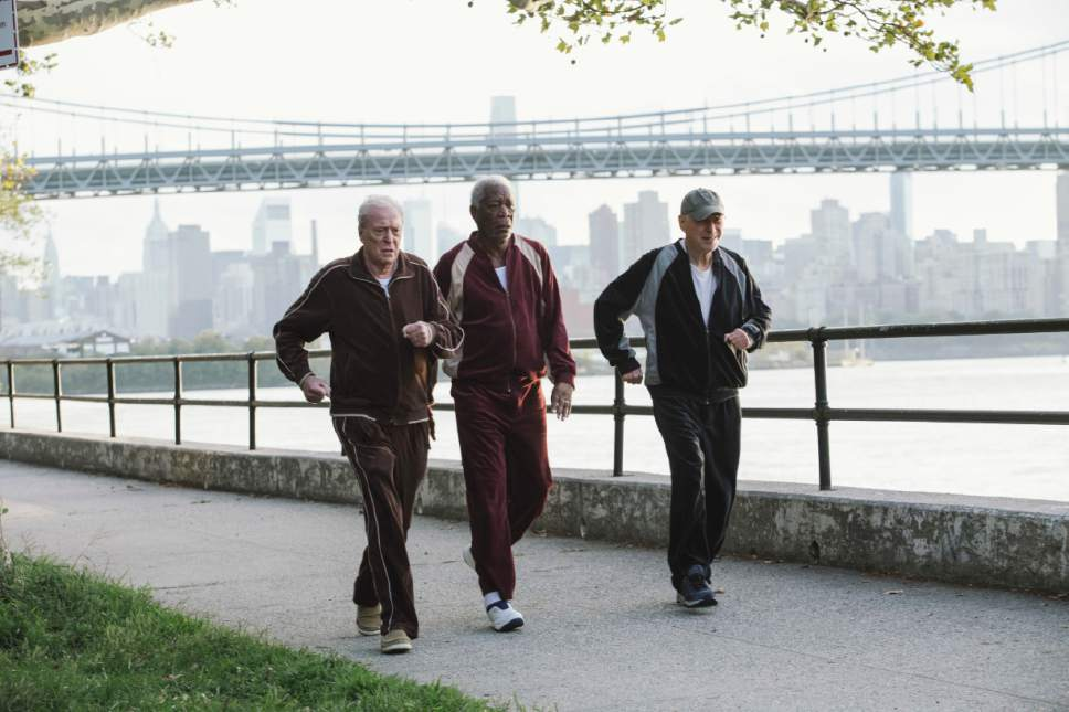 """In this image released by Warner Bros. Pictures, Michael Caine, from left, Morgan Freeman and Alan Arkin appear in a scene from """"Going in Style."""" (Atsushi Nishijima/Warner Bros. Pictures via AP)"""