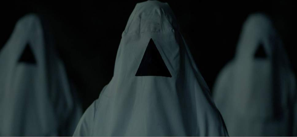 """Hooded figures menace a hospital, in a scene from the horror thriller """"The Void."""" Courtesy Screen Media Films"""