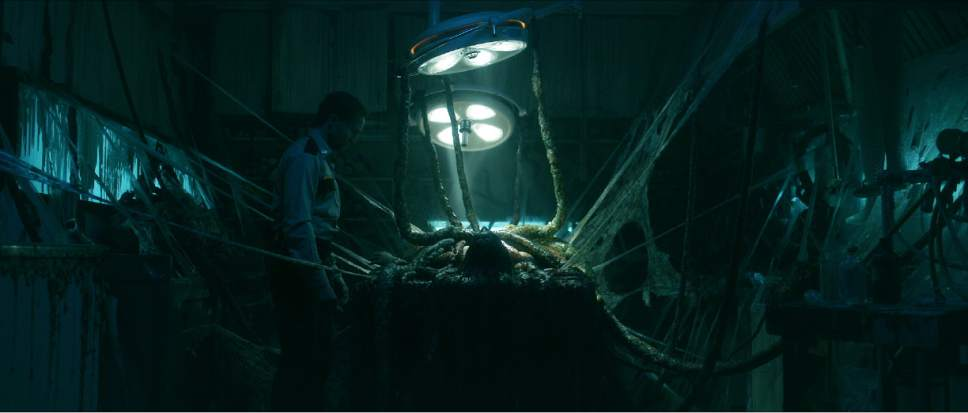"""Deputy Daniel Carter (Aaron Poole, left) makes a grisly discovery in a soon-to-be-abandoned hospital, in the horror thriller """"The Void."""" Courtesy Screen Media Films"""