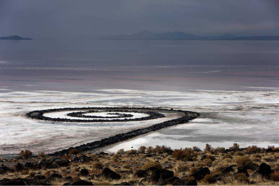"A Wednesday, Nov. 20, 2013 photo shows The Spiral Jetty earth works on the north edge of the Great Salt Lake created by artist Robert Smithson in 1970. On March 25, 2017, Republican Gov. Gary Herbert signed a bill that designates the iconic ""Spiral Jetty"" sculpture on the shore of the Great Salt Lake an official state work of art. (Francisco Kjolseth/The Salt Lake Tribune via AP)"