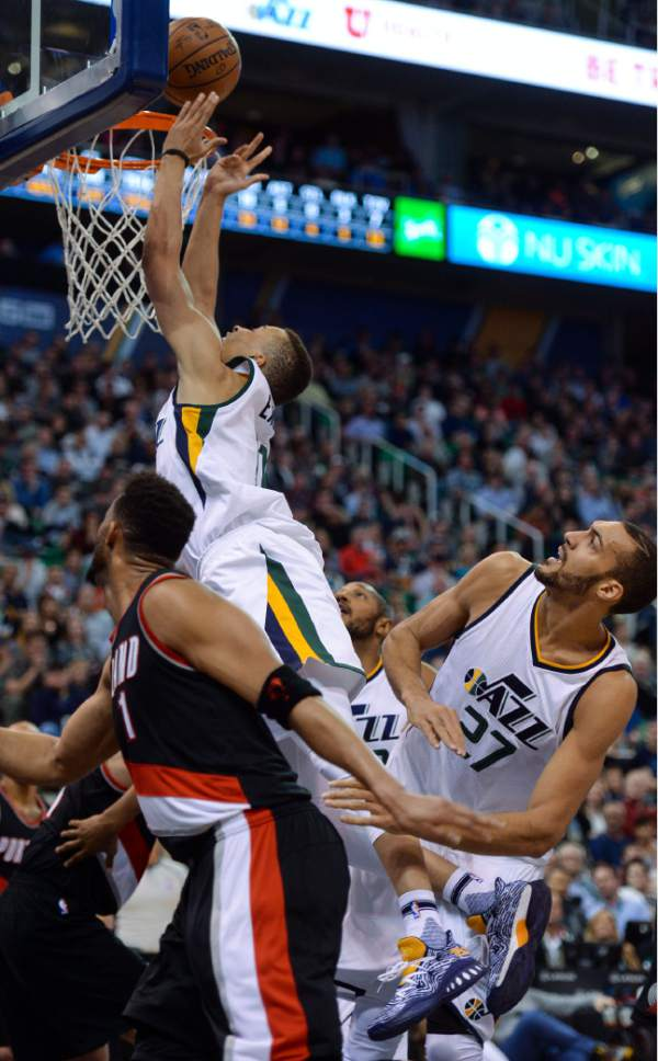 Steve Griffin  |  The Salt Lake Tribune   Utah Jazz guard Dante Exum (11) stretches for the basket as the ball squirts away from him during the Utah Jazz versus Portland Trailblazers NBA basketball game at Vivint Smart Home Arena in Salt Lake City Tuesday April 4, 2017.