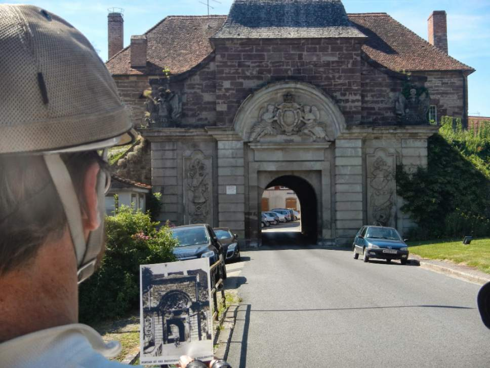 Phil Keoghan compares a photo from the 1928 Tour de France to the same site in present-day France. Courtesy of NowTV