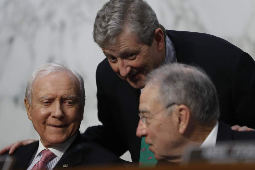 Senate Judiciary Committee member Sen. John Kennedy, R-La., center, talks with Committee Chairman Sen. Charles Grassley, R-Iowa, right and Sen. Orrin Hatch, R-Utah on Capitol Hill in Washington, Tuesday, March 21, 2017, during the committee's confirmation hearing for Supreme Court Justice nominee Neil Gorsuch. (AP Photo/Pablo Martinez Monsivais)
