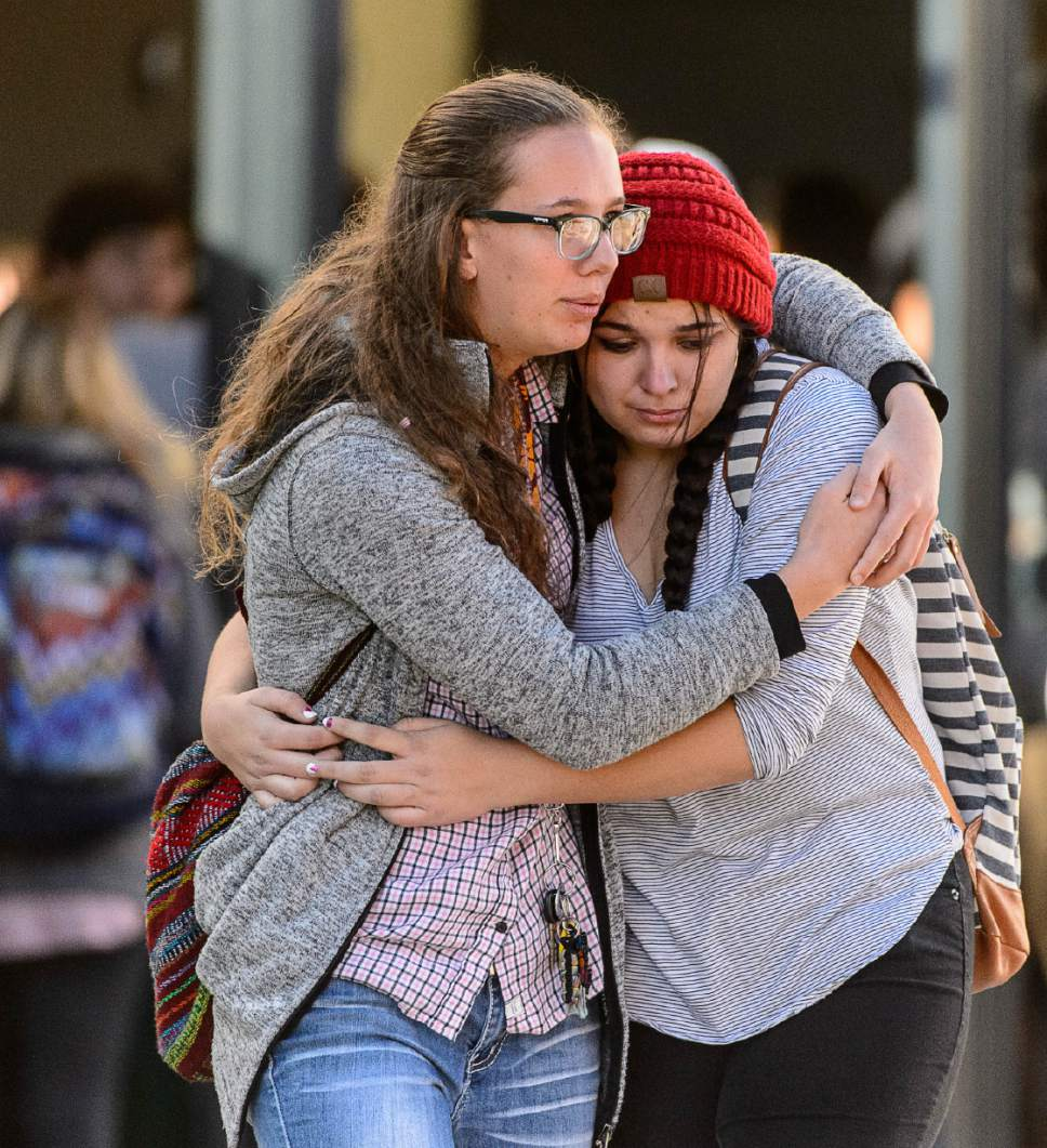 Trent Nelson     The Salt Lake Tribune Students Holly Hilton and Albany Cox embrace after a 16-year-old boy allegedly stabbed several other male students before reportedly turning his knife on himself at Mountain View High School in Orem Tuesday November 15, 2016.