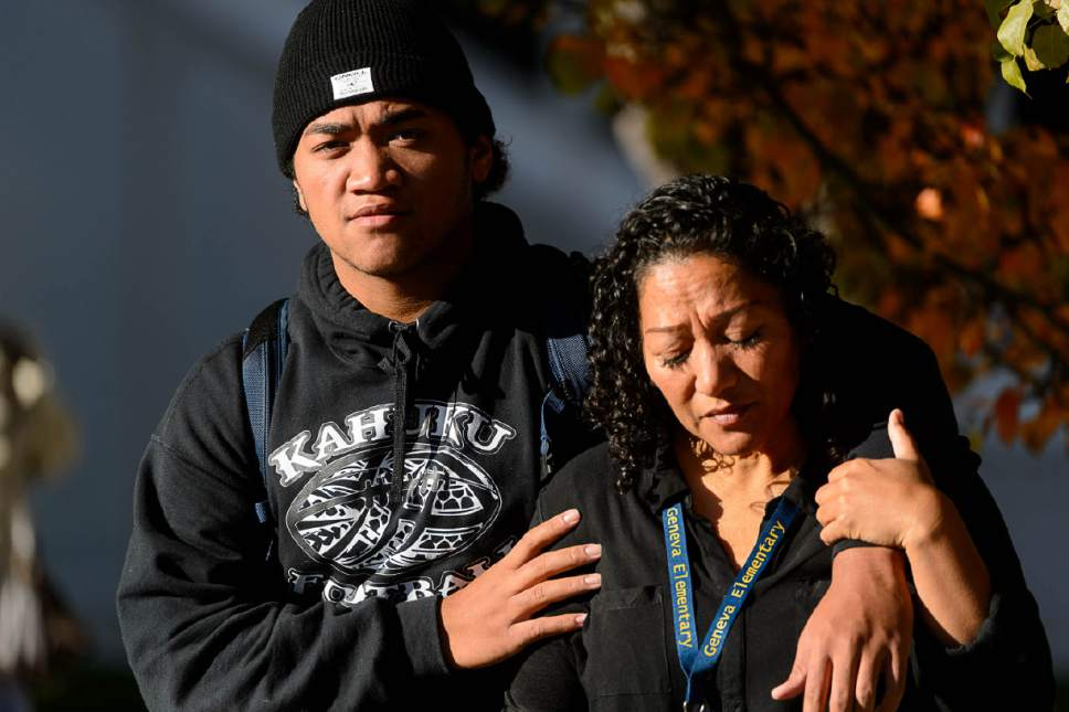 Trent Nelson     The Salt Lake Tribune Seta Unga, right, with her son Aisea. Parents pick up their students after a 16-year-old boy allegedly stabbed several other male students before reportedly turning his knife on himself at Mountain View High School in Orem Tuesday November 15, 2016.