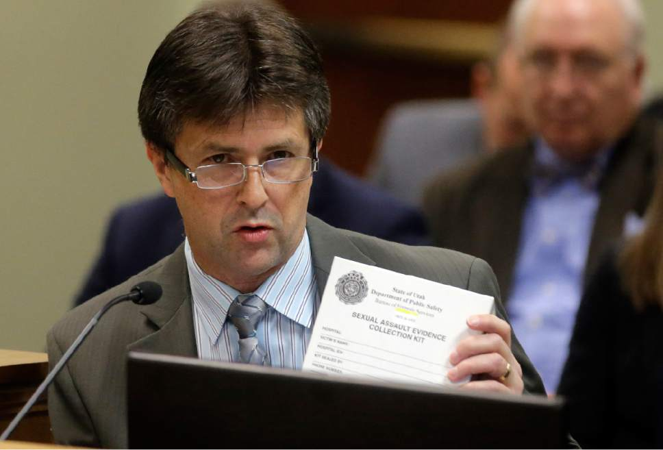 This Feb. 8, 2017, photo, Utah State Crime Lab Director Jay Henry holds a sexual assault evidence collection kit as he speaks during committee meeting at the state Capitol in Salt Lake City. Utah crime lab officials are feeling optimistic as they work to speed up the time it takes to process sexual assault evidence kits, after lawmakers approved a measure last month that sends more than $1 million to go toward this effort. (AP Photo/Rick Bowmer)