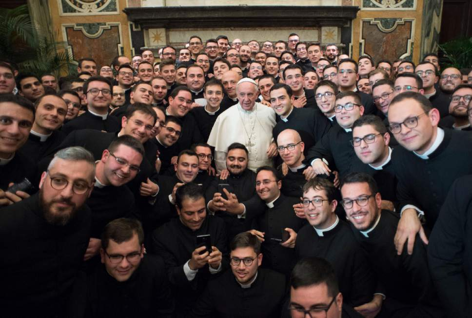 Pope Francis poses with members of the International Rural Catholic Association, at the Vatican Saturday, Dec. 10, 2016. (L'Osservatore Romano/Pool Photo via AP)