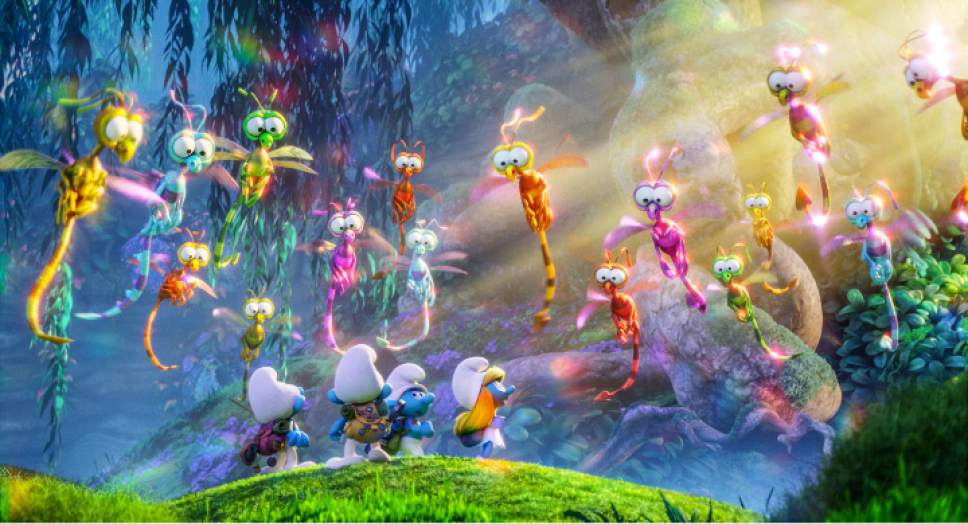 "Clumsy (voiced by Jack McBrayer), Brainy (voiced by Danny Pudi), Hefty (voiced by Joe Mangianello) and Smurfette (voiced by Demi Lovato), from left, encounter strange creatures when they venture into the Forbidden Forest, in a scene from ""Smurfs: The Lost Village."" Courtesy Sony Amination / Columbia"