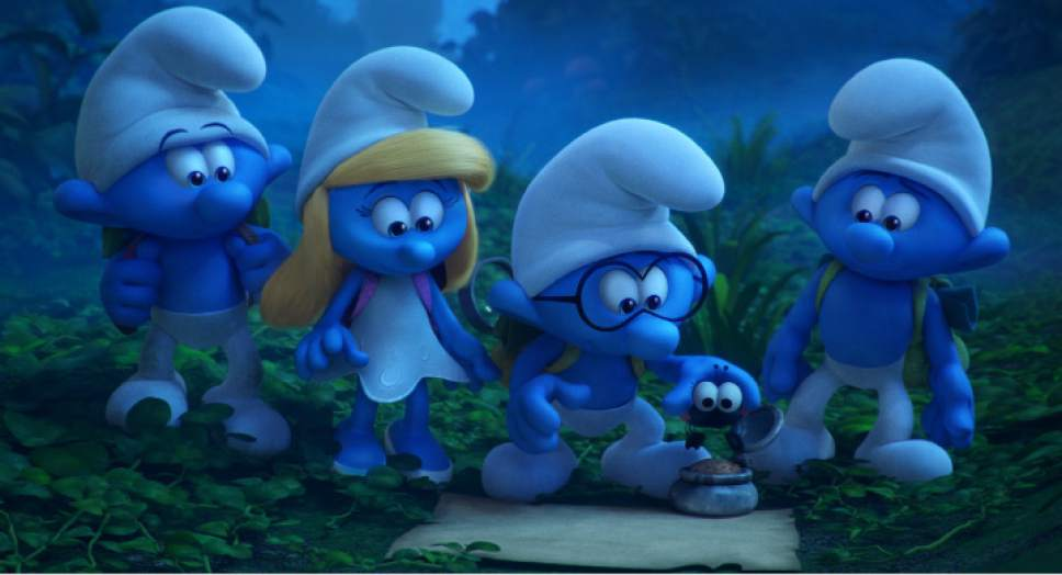 "Clumsy (voiced by Jack McBrayer), Smurfette (voiced by Demi Lovato), Brainy (voiced by Danny Pudi) and Hefty (voiced by Joe Mangianello), from left, discuss their plan for traversing the Forbidden Forest, in a scene from ""Smurfs: The Lost Village."" Courtesy Sony Amination / Columbia"