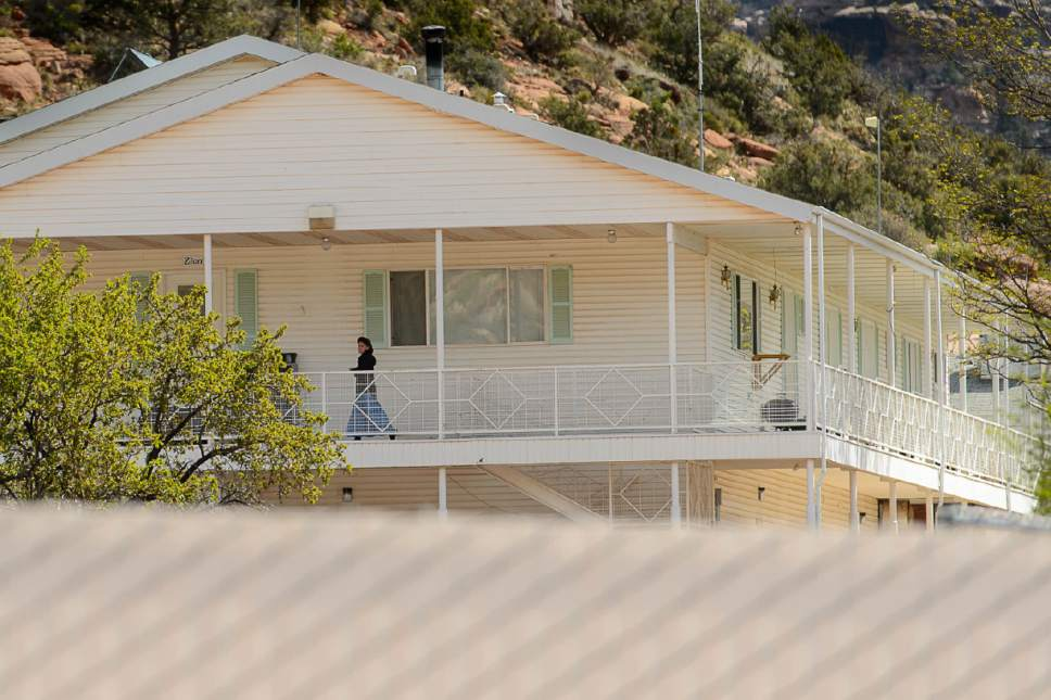 For a polygamous sect homes have gone and 39 apostates for Plural of balcony