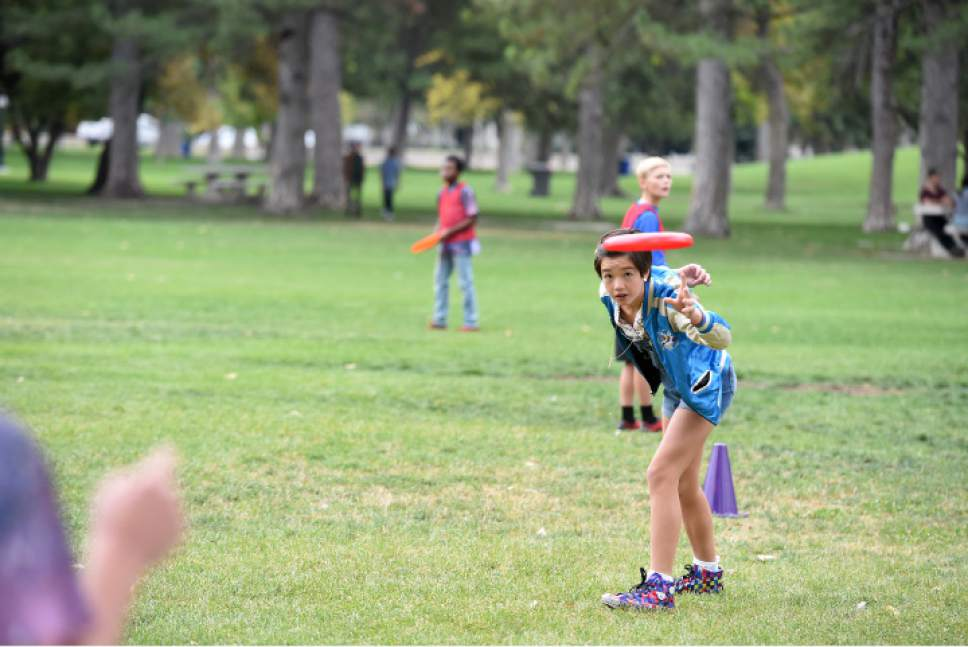 "Andi (Peyton Elizabeth Lee) plays Frisbee in Salt Lake City's Liberty Park in the new Disney Channel series ""Andi Mack."" Fred Hayes  