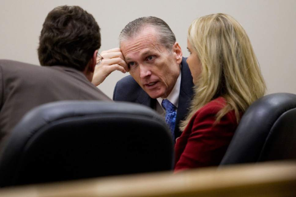 Mark Johnston  |  Pool Photo  Martin MacNeill speaks to his attorneys Susanne Gustin, right, and Randy Spencer during his trial at the Fourth District Court in Provo Tuesday, Nov. 5, 2013. MacNeill is charged with murder for allegedly killing his wife Michele MacNeill in 2007.