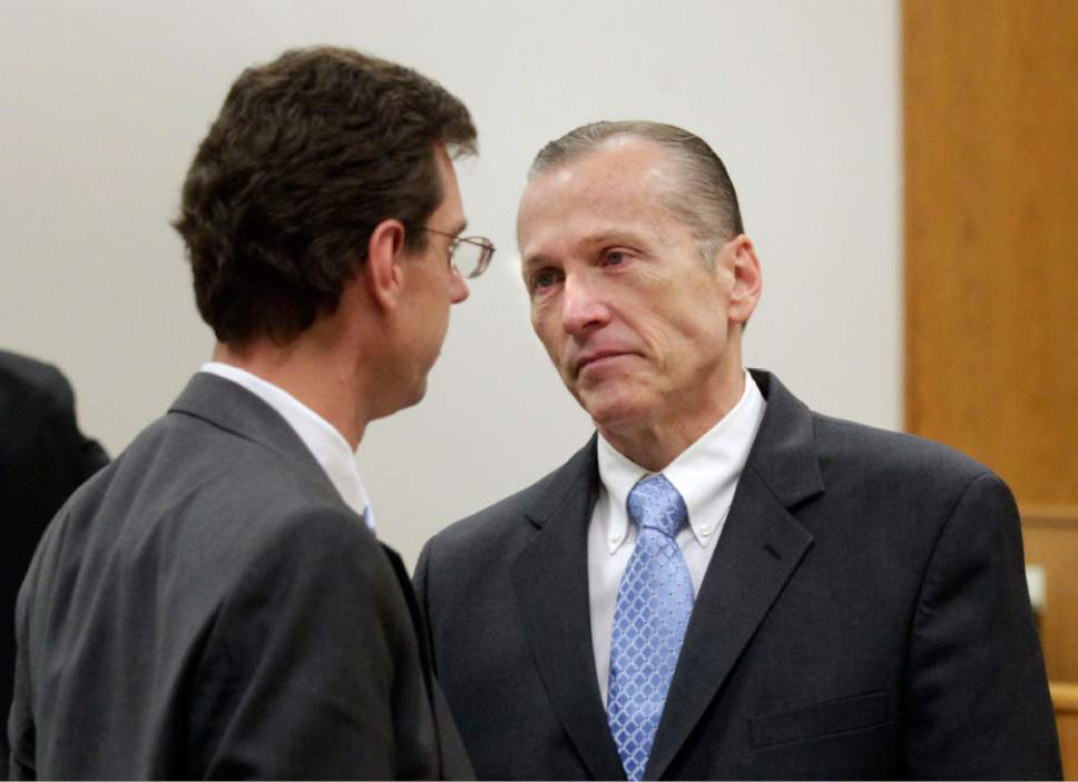 Al Hartmann  |  The Salt Lake Tribune  Defense lawyer Randy Spencer left, talks to is client Martin MacNeill at the conclusion of his three week murder trial in Provo, Utah 4th District Court Friday November 8, 2013.