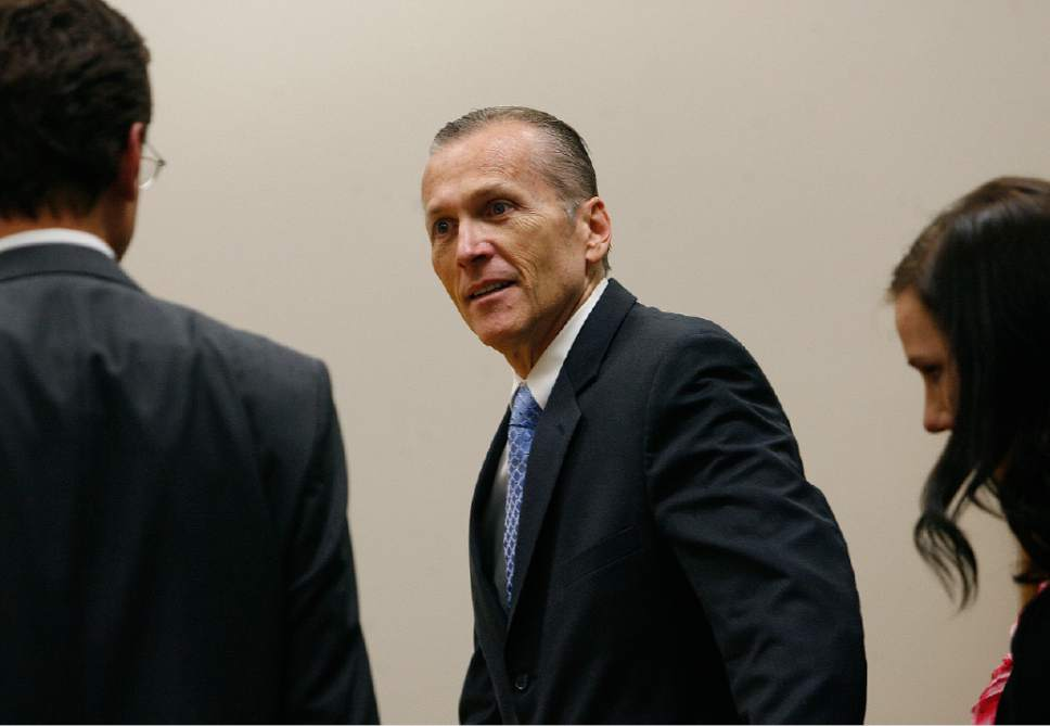 Scott Sommerdorf   |  The Salt Lake Tribune  Martin MacNeill greets his defense team as he enters the courtroom after the jury reached a verdict. MacNeill was found guilty of murder and obstruction of justice early Saturday morning, November 9, 2013.