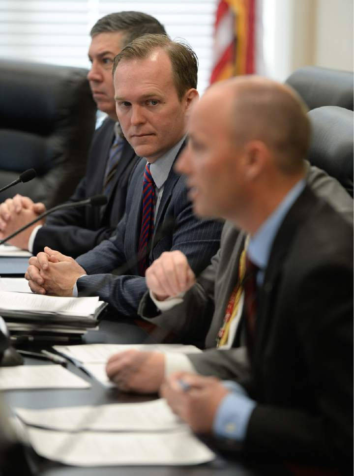 Francisco Kjolseth | The Salt Lake Tribune Lt. Gov. Spencer Cox, right, leads the State Homeless Coordinating Committee as they meet to ratify decision of Salt Lake County Mayor Ben McAdams, top center, to put the the one non-Salt Lake City homeless resource center in South Salt Lake at 3380 So. 1000 West. The group gathered at the Capitol Complex on Monday, April 10, 2017.