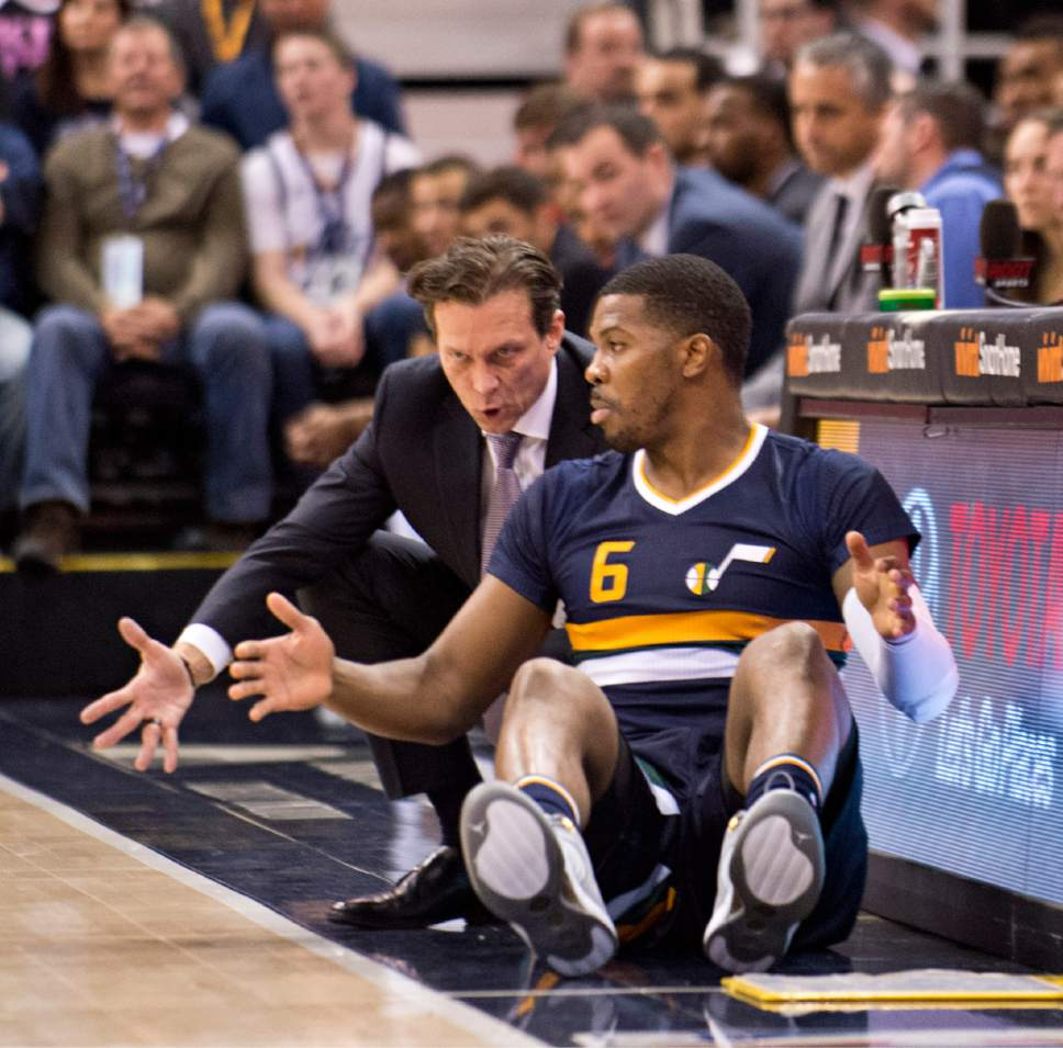 Lennie Mahler  |  The Salt Lake Tribune  Utah Jazz head coach Quin Snyder speaks with Joe Johnson before he enters the game in the first half of a game between the Utah Jazz and the Boston Celtics at Vivint Smart Home Arena on Saturday, Feb. 11, 2017.