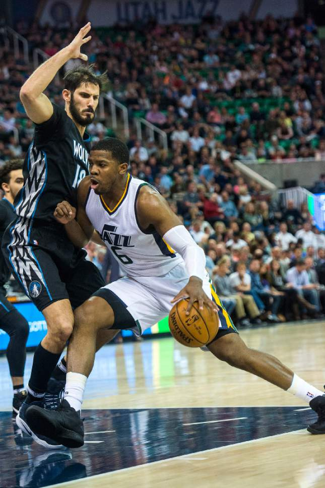 Chris Detrick  |  The Salt Lake Tribune Utah Jazz forward Joe Johnson (6) runs past Minnesota Timberwolves forward Omri Casspi (18) during the game at Vivint Smart Home Arena Friday, April 7, 2017.