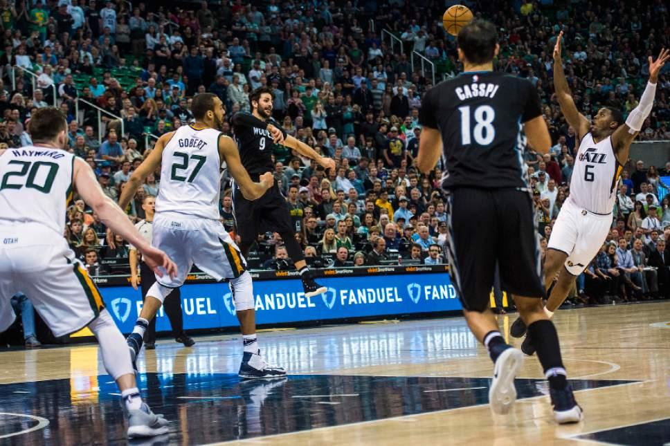 Chris Detrick  |  The Salt Lake Tribune Minnesota Timberwolves guard Ricky Rubio (9) attempts to pass around Utah Jazz forward Joe Johnson (6) during the game at Vivint Smart Home Arena Friday, April 7, 2017.  Utah Jazz defeated Minnesota Timberwolves 120-113.