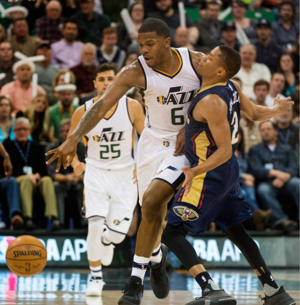Rick Egan  |  The Salt Lake Tribune  Utah Jazz forward Joe Johnson (6) collides with New Orleans Pelicans guard Tim Frazier (2), in NBA action Utah Jazz vs. New Orleans Pelicans, in Salt Lake City, Monday, March 27, 2017.