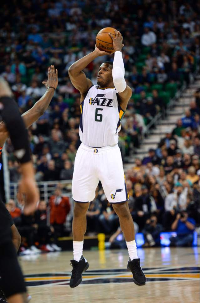 Steve Griffin  |  The Salt Lake Tribune   Utah Jazz forward Joe Johnson (6) fires and makes a three-pointer during the Utah Jazz versus Portland Trailblazers NBA basketball game at Vivint Smart Home Arena in Salt Lake City Tuesday April 4, 2017.
