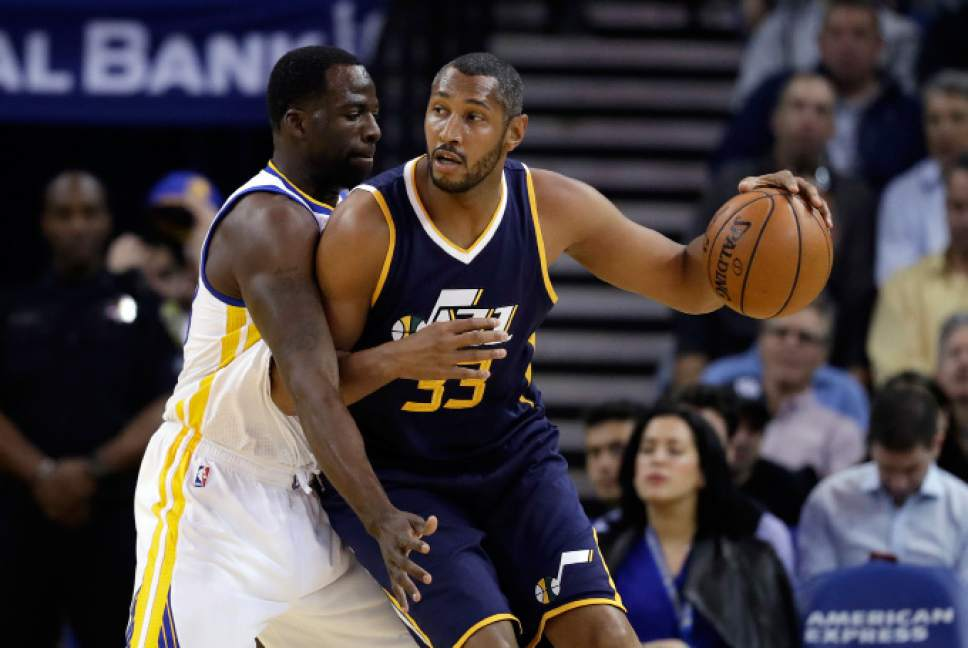 Utah Jazz' Boris Diaw, right, is defended by Golden State Warriors forward Draymond Green during the first half of an NBA basketball game, Monday, April 10, 2017, in Oakland, Calif. (AP Photo/Marcio Jose Sanchez)