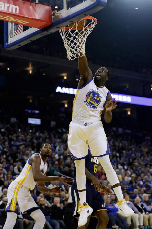 Golden State Warriors forward Draymond Green (23) dunks against the Utah Jazz during the first half of an NBA basketball game Monday, April 10, 2017, in Oakland, Calif. (AP Photo/Marcio Jose Sanchez)