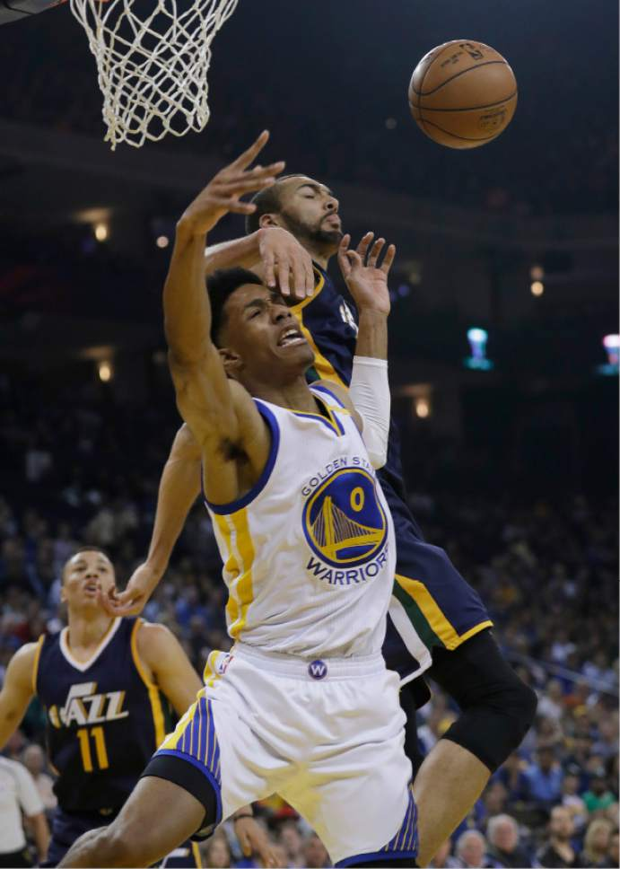 Golden State Warriors guard Patrick McCaw (0) has his shot blocked by Utah Jazz center Rudy Gobert during the first half of an NBA basketball game, Monday, April 10, 2017, in Oakland, Calif. (AP Photo/Marcio Jose Sanchez)