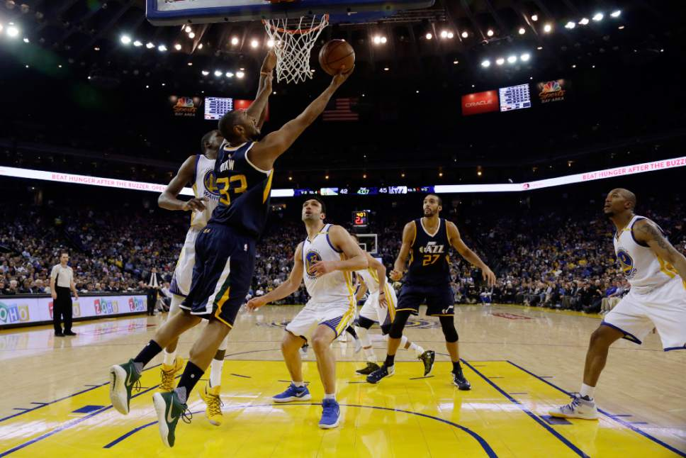 Utah Jazz' Boris Diaw (33) drives to the basket against the Golden State Warriors during the first half of an NBA basketball game, Monday, April 10, 2017, in Oakland, Calif. (AP Photo/Marcio Jose Sanchez)